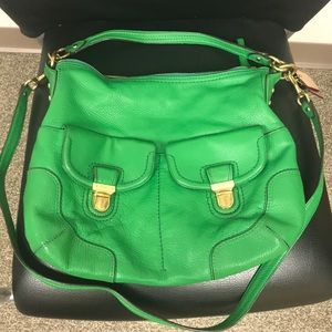 Green coach bag with shoulder strap and crossbody